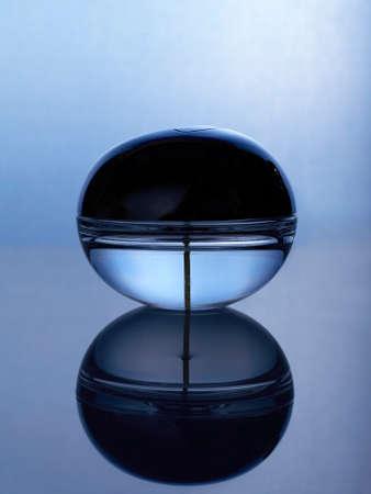 perfume spray: Crystal bottle with perfume spray Stock Photo
