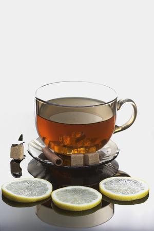 ice tongs: Tea with lemon, sugar and cinnamon