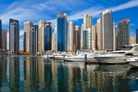 Boats and yachts parked in famous Marina district in Dubai, UAE