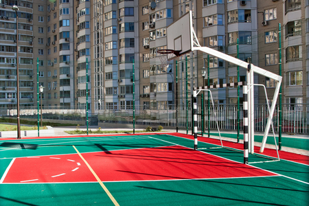all weather: Empty basketball court in public playground Stock Photo
