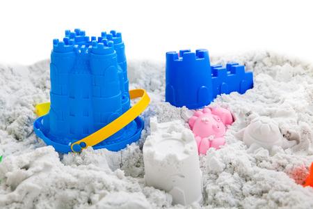 white sand: Fun kinetic sand isolated on white background Stock Photo