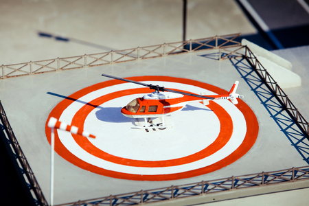 helideck: Helicopter is landing on heliport. Park of miniature in Rimini