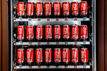 MOSCOW, RUSSIA - MARCH 15: Vending machine full of coca-cola cans in Moscow, Russia on March 13, 2015. Coca-Cola is a carbonated soft drink sold in stores, restaurants, and vending machines throughout the world. Editorial