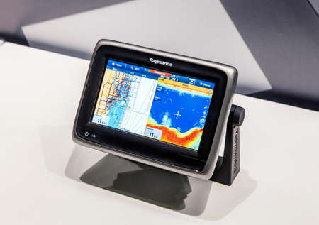 demonstrating: MOSCOW, RUSSIA - MARCH 11: Moscow International Boat Show 2015, demonstrating Raymarine GPS system, March 11, 2015 in Moscowi, Russia. Raymarine specialises in marine electronics. Editorial