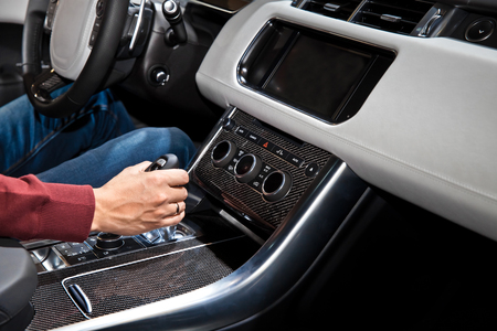 gear handle: Driver man hand holding automatic transmission in car