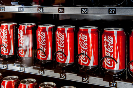 MOSCOW, RUSSIA - MARCH 15: Vending machine full of coca-cola cans in Moscow, Russia on March 13, 2015. Coca-Cola sold in stores, restaurants, and vending machines throughout the world.
