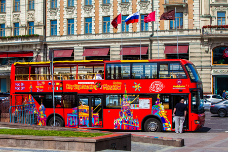 excursions: MOSCOW, RUSSIA - JULY 03, 2015: Red double-decker tour bus on Moscow street.  Hop On-Hop Off tour bus offers excursions in eight languages