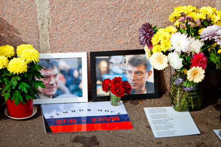 assassinated: MOSCOW, RUSSIA - SEPTEMBER 1, 2015: Flowers in the murder place of the Russian politician Boris Nemtsov in Moscow, Russia. Nemtsov was assassinated on 27 February 2015 near Kremlin in Moscow.