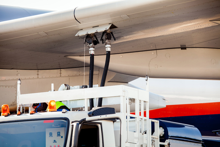 refueling: Process of aircraft (airplane) refueling closeup Stock Photo