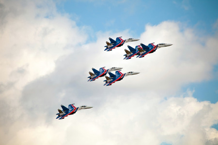 ZHUKOVSKY, RUSSIA - AUG 30, 2015: Aerobatic teams Russian Knights (vityazi) on planes MiG-29 on the International Aviation and Space salon MAKS-2015