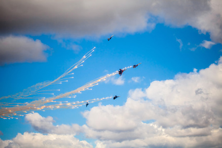 pilotage: ZHUKOVSKY, RUSSIA - AUG 30, 2015: Aerobatic teams Russian Knights (vityazi) on planes MiG-29 on the International Aviation and Space salon MAKS-2015