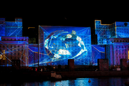 reality: MOSCOW, RUSSIA - OCTOBER 03, 2015: International Festival Circle of Light. Laser video mapping show on facade of the Ministry of Defense in Moscow, Russia