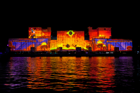 mapped: MOSCOW, RUSSIA - OCTOBER 02, 2015: International Festival Circle of Light. Laser video mapping show on facade of the Ministry of Defense in Moscow, Russia Editorial