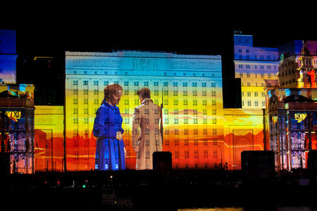 light show: MOSCOW, RUSSIA - OCTOBER 02, 2015: International Festival Circle of Light. Laser video mapping show on facade of the Ministry of Defense in Moscow, Russia Editorial