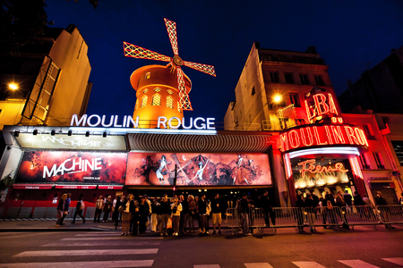 scandalous: PARIS - AUGUST 29: The Moulin Rouge by night, on August 29, 2011 in Paris, France. Moulin Rouge is a famous cabaret built in 1889, locating in the Paris red-light district of Pigalle