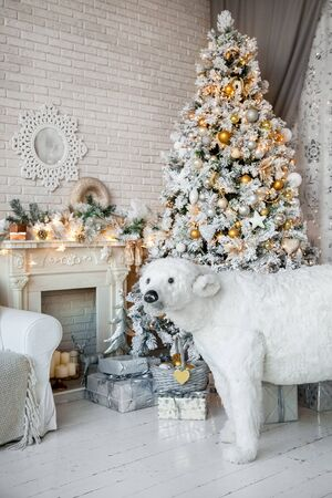 classic living room: Christmas and New Year decorated interior room with presents and New year tree and white bear