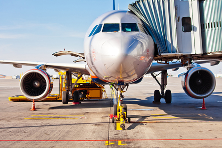 aeroplane: Jet aircraft docked in airport
