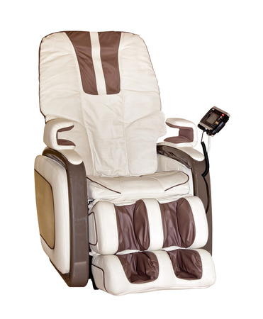 holistic care: Beige leather comfortable reclining massage chair isolated on white background Stock Photo