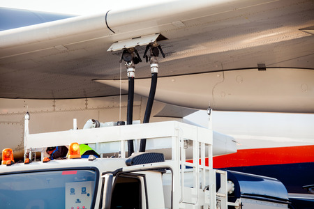 Refuelling the aircraft close up process Stock Photo