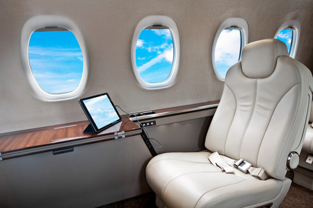 Business Jet airplane interior with blue sky outside Standard-Bild