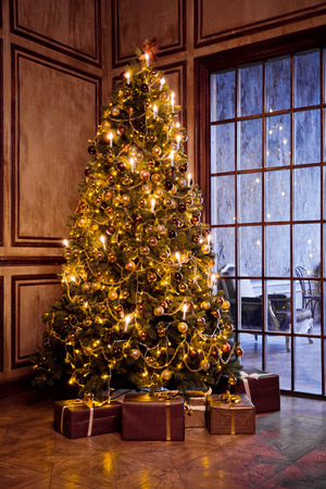 Classic christmas and New Year decorated interior room with presents and New year tree Фото со стока