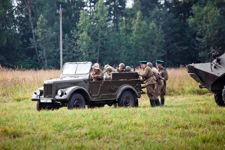 wehrmacht: MOSCOW, RUSSIA - AUGUST 09, 2015: Reconstruction of World War 2. Military vehicle on the battle field. Editorial