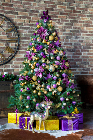 tree vertical: Christmas and New Year decorated interior room with presents and New year tree - vertical shot Stock Photo