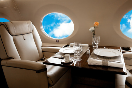 private airplane: Aircraft (jet) porthole with blue sky view, flight by business class