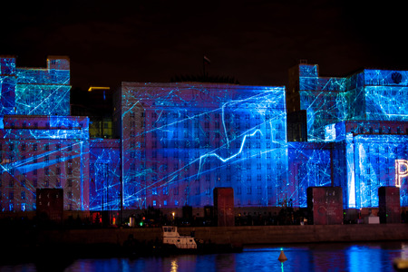 mapped: MOSCOW, RUSSIA - OCTOBER 03, 2015: International Festival Circle of Light. Laser video mapping show on facade of the Ministry of Defense in Moscow, Russia