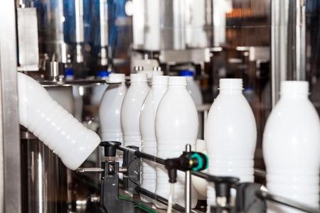 packaging equipment: Packaging bottles line in the milk industry Stock Photo