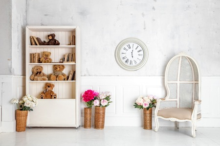 view an elegant wardrobe: Modern light room interior with wardrobe, armchair and clocks on the wall Stock Photo