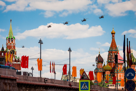 demonstrator: MOSCOW, RUSSIA - MAY 7, 2016: Avia parade in Moscow. Group of Russian helicopters in the sky on parade of Victory in World War II in Moscow, Russia Editorial