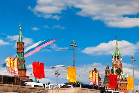 avia: MOSCOW, RUSSIA - MAY 7, 2016: Avia parade in Moscow. Group of Russian fighters Sukhoi Su-25 with painted russian flag in the sky on parade of Victory in World War II in Moscow, Russia