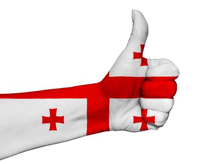 Hand with thumb up painted in colors of Georgia flag isolated on white background
