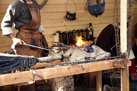bellows: The annual festival in Kolomenskoye. Reconstruction of Ancient Rus. Blacksmith blows the bellows