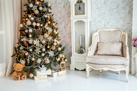 indoor background: Christmas and New Year decorated interior room with presents and New year tree