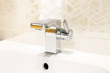 colour in: Modern faucet of chrome color in bathroom interior