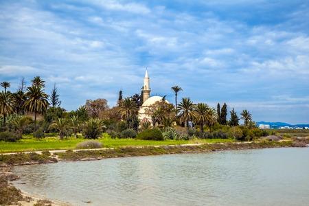 Hala Sultan Tekke or the Mosque of Umm Haram is a Muslim shrine on the west bank of Larnaca Salt Lake, near Larnaca, Cyprus Stock Photo