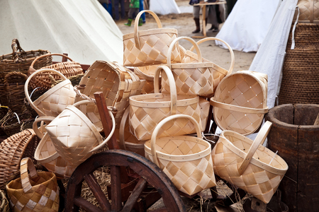 ancient times: Basket of birch bark on the market. Reconstruction of ancient times