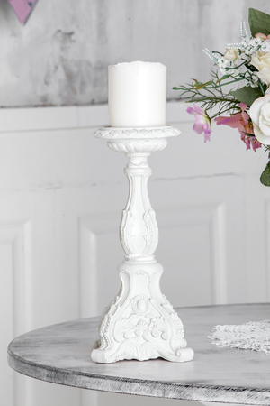 candle holder: White candle holder on the table in white room interior Stock Photo