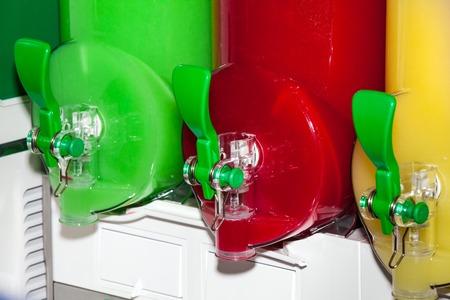 slushy: Three moist juice machines in action. Machine for making ice slushy drinks Stock Photo