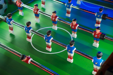 Soccer table game. Football players close up view
