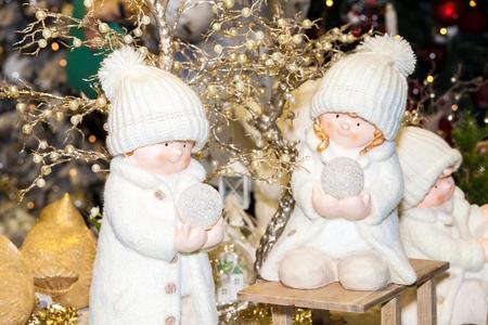 Bacground: Two angel boy toys on christmas bacground