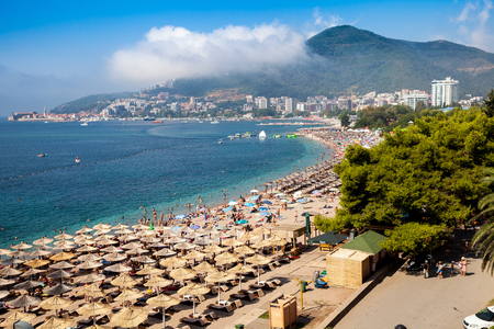 budva: Budva, Montenegro - August, 2016: Beaches with a lot of people and sun umbrellas in Budva, Montenegro