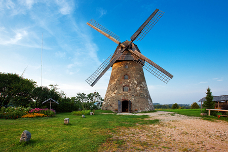 Traditional dutch windmill in Latvia Stock Photo