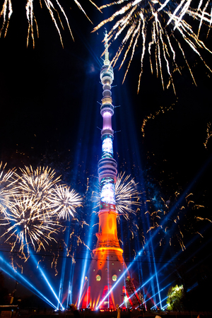 MOSCOW, RUSSIA - OCTOBER, 2014: International Festival Circle of Light. Laser video mapping show on Ostankino TV tower in Moscow, Russia. 3D projection mapping on building and firework show