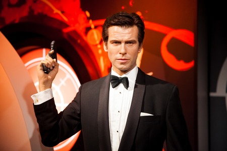 Amsterdam, Netherlands - March, 2017: Wax figure of Pierce Brosnan as James Bond 007 agent in Madame Tussauds Wax museum in Amsterdam, Netherlands