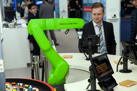 Fanuc industrial robot hand on exhibition Cebit 2017 in Hannover Messe, Germany