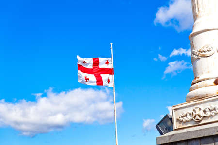 Georgian flag waving in the blue sky Stock Photo