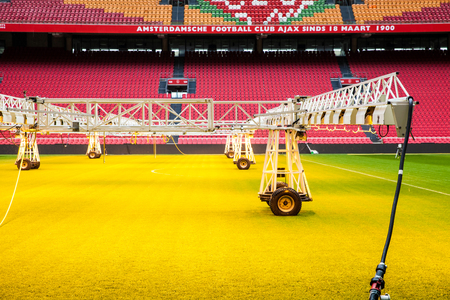 ajax: Interior view of Amsterdam Ajax Football Arena. System of care and sprinkling of the lawn at the stadium Editorial